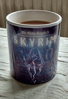 Yes, that is a Skyrim mug. Dragon fires keeps the tea hot. Not really. Video games rule.